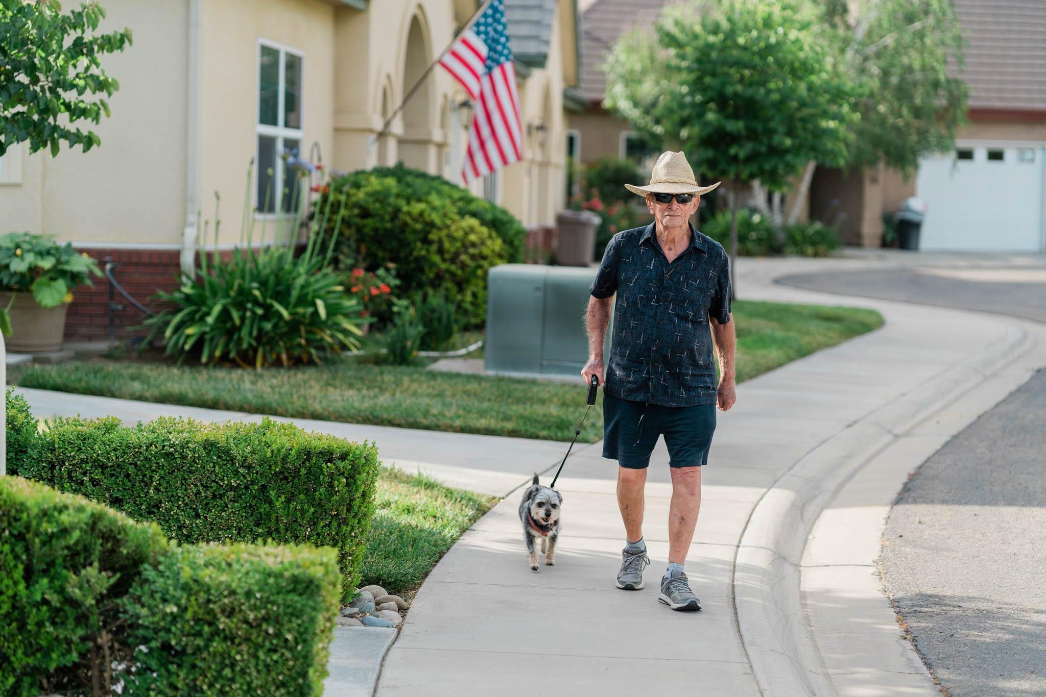 Senior Walking His Dog Around Sierra Village